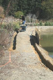 Sunken rain garden, concrete paver installation by Envisions of Raleigh - 2008